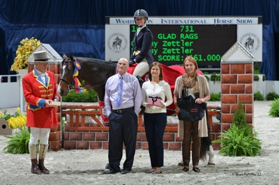 Amy Zettler and Glad Rags winning last year's $10,000 WIHS Adult Hunter Championship. Photo © Shawn McMillen Photography.