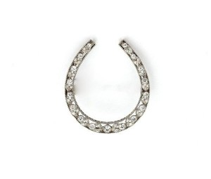 A vintage platinum horseshoe pin set with approximately 1.50 carats of diamonds, created circa 1925, is in the WIHS Silent Auction thanks to Tiny Jewel Box.