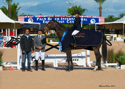 Frances Land and Vieanne in their winning presentation with ringmaster Gustavo Murcia and Luis Miguel Martinez of G&C Farm