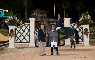 Charlie Jacobs and Flaming Star in their winning presentation with ringmaster Gustavo Murcia and Equestrian Sport Productions President Michael Stone