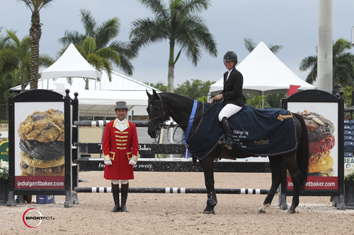 Beezie Madden and Cortes 'C' in their winning presentation with ringmaster Gustavo Murcia