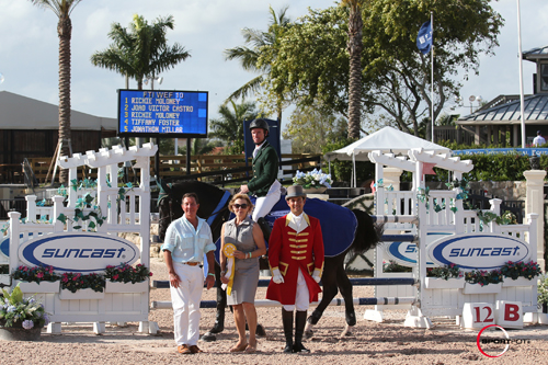 Richie Moloney and Alsvid  in their winning presentation with Tom and Jeannie Tisbo of Suncast with ringmaster Gustavo Murcia
