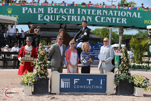 Scott Brash and Hello Sanctos in their winning presentation with ringmaster Gustavo Murcia, Equestrian Sport Productions President Mark Bellissimo, Katherine Bellissimo, Mary Kay Shaughnessy, and Dennis Shaugnessy – Chairman of the Board of FTI Consulting