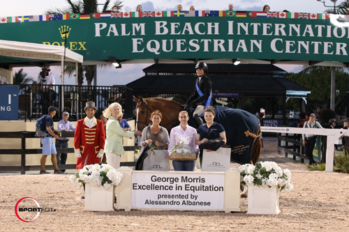 Victoria Colvin and Patrick with ringmaster Gustavo Murcia, Dr. Betsee Parker, Cristina Pozzati of Alessandro Albanese Italy, Michelle Lucey, business manager for Alessandro Albanese, and Claire Moriarty of Horseware Ireland.
