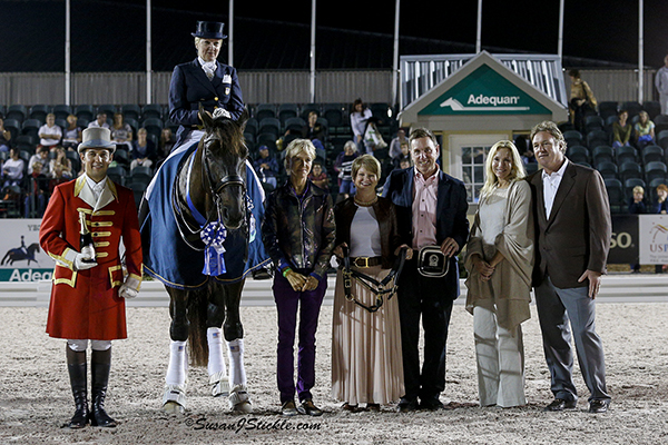 Tina Konyot and Calecto V with ringmaster Gustavo Murcia, judge Anne Gribbons, Terri Kane of Diamante Farms, Allyn Mann of Adequan, and Katherine and Mark Bellissimo of Equestrian Sport Productions