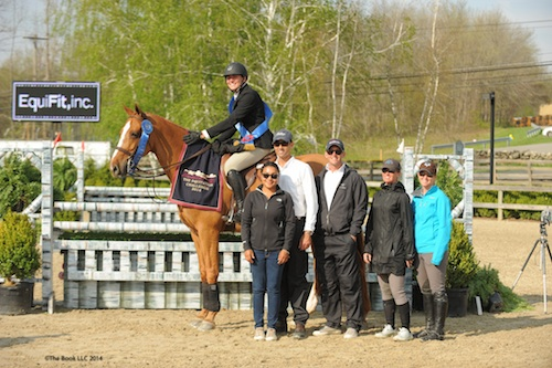 Geoffrey Hesslink and Belano V in their winning presentation with Siri duPont-Hurley from EquiFit, inc. and trainers from Heritage Farm, Andre Dignelli, Brady Mitchell, Laena Romond, and Dottie Areson.