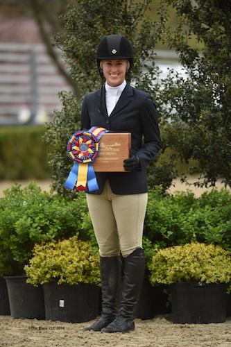Lindsay Strafuss receives her Grand Adult Amateur Hunter Championship award.