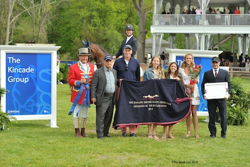 McLain Ward in his winning presentation with (L to R): ringmaster John Franzreb, Kamran Hakim of Old Salem Farm, Stephen Kincade of The Kincade Group, Emily Sheppard, Natalie Christopoul, Gretchen Kincade, and Scott Hakim.