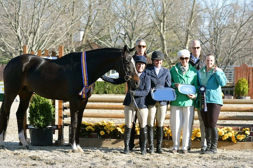 Scottsdale and Debbie McCarthy in their winning presentation with Vivien Malloy (center) and family.