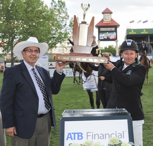 Eric Lamaze lifts his first trophy of the 2014 Spruce Meadows Summer Series Dave Mowat, President & CEO, ATB.