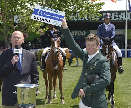 Shane Sweetnam raises his winning check.