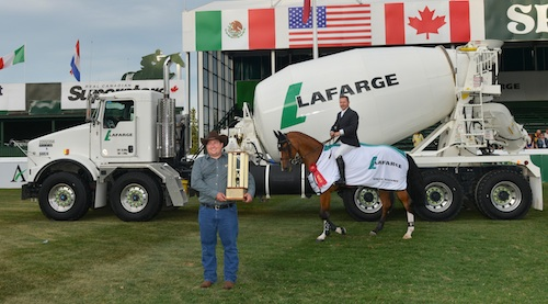 Eric Lamaze and Fine Lady 5 in their winning presentation with Jonathan Moser, Director Environment & Public Affairs, Lafarge Western Canada