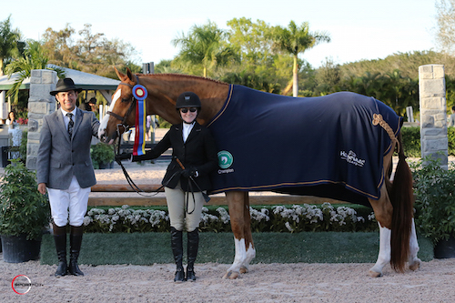 Becky Gochman and Fredrick in their championship presentation with ringmaster Gustavo Murcia