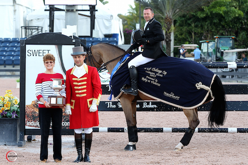 Eric Lamaze and Fine Lady 5 were awarded the Barry Louise Lane Perpetual Memorial Trophy in their winning presentation with Debbie Lane and ringmaster Gustavo Murcia