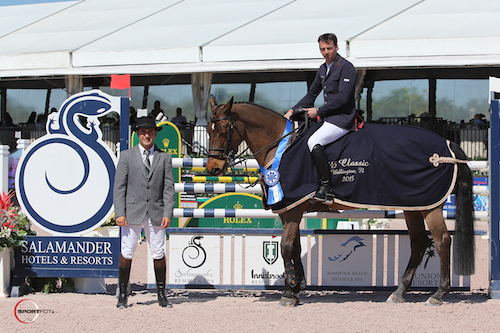 Harrie Smolders and Exquis Walnut de Muze in their winning presentation with ringmaster Gustavo Murcia