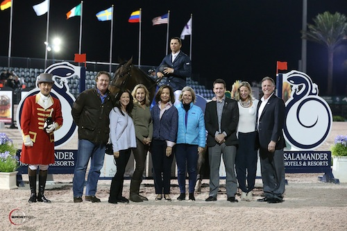 Kent Farrington and Blue Angel in their winning presentation with ringmaster Gustavo Murcia, Equestrian Sport Productions CEO Mark Bellissimo, Ellen Crown, Katherine Bellissimo, Robin Parsky, Lisa Lourie,  Matt Owen and Julie Banner of Salamander Hotels & Resorts, and Rob Banner