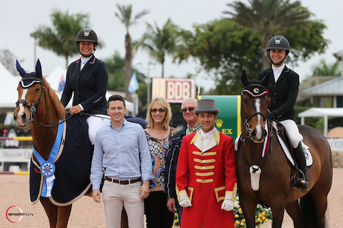 Lisa Goldman and Morocco with Georgina Bloomberg and South Street in the presentation with Jim and Suzanne Cantrell and Matt Varney of Wellington Equestrian Realty as well as ringmaster Gustavo Murcia