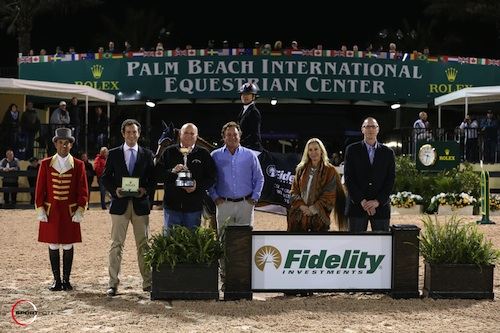 Marie Hecart and Myself de Breve in their winning presentation with ringmaster Gustavo Murcia, Rolex representative Anthony Schaub, Mayor Bob Margolis presenting the Village of Wellington Cup, Equestrian Sport Productions CEO and Principal Mark and Katherine Bellissimo, and Russell Binkley, Branch Manager/Vice President, Fidelity Investments®, Palm Beach Island Investor Center