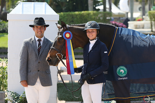 Alliy Moyer and Carlson in their championship presentation with ringmaster Gustavo Murcia