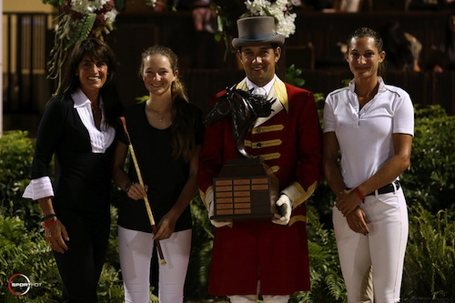 Lucy Deslauriers accepts the Potcreek Meadow Farm Junior Sportsmanship Trophy  from ringmaster Gustavo Murcia and Cara and Carly Anthony