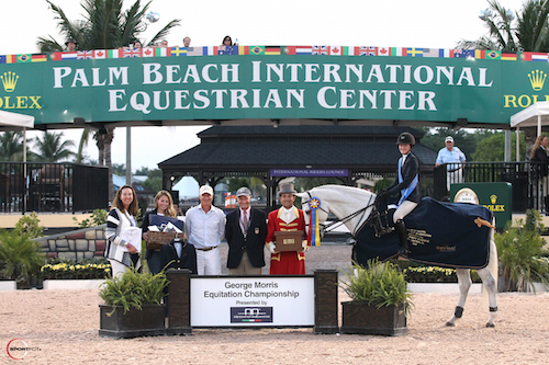 Lucy Deslauriers in her winning presentation aboard Class Action with Stacia Madden, Sarah Swezey, North American Manager for Alessandro Albanese, Mario Deslauriers, George H. Morris, and ringmaster Gustavo Murcia