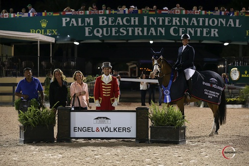 Paige Johnson and Dakota in their winning presentation with groom Agustin Aquino along with Carol Sollak and Amy Carr of Engel & Völkers and ringmaster Gustavo Murcia