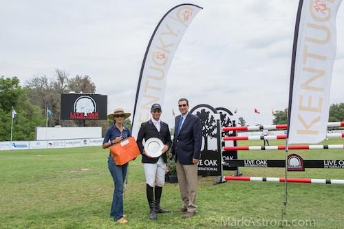 "Carolina Ceruti and Cesar Hirsch of Equis Boutique with the ""Best Presented Horse"" Award winner Vinton Karrasch."