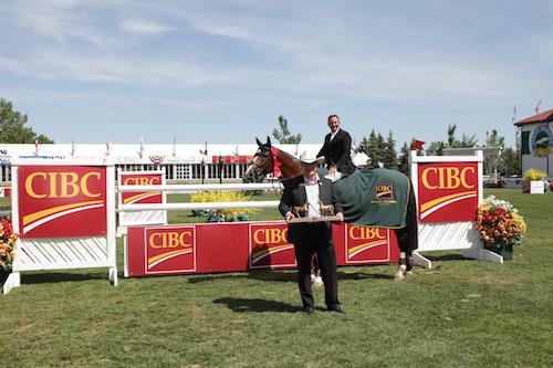 Eric Lamaze and                           Coco Bongo in their winning presentation with                           Tom Weber, Alberta Region Head, CIBC
