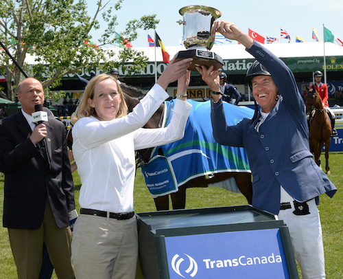 Rich Fellers raises the winning trophy with a representative from TransCanada