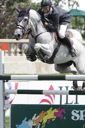 Eduardo Menezes of BRA riding Carushka 2