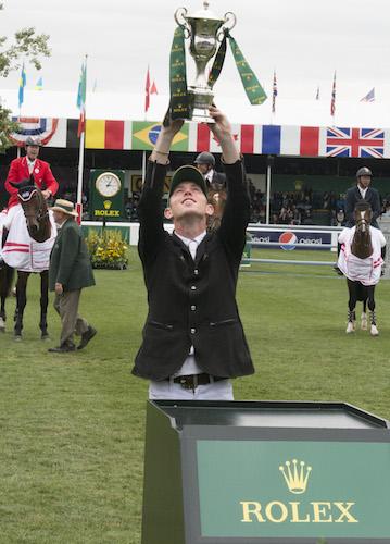 Scott Brash celebrates his win in the Rolex Grand Slam of Show Jumping