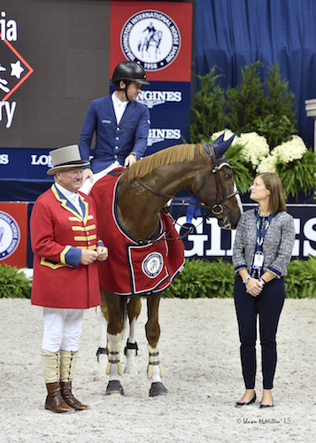 Conor Swail and Simba de la Roque enjoy their winning presentation with ringmaster John Franzreb and WIHS Executive Director Bridget Love Meehan