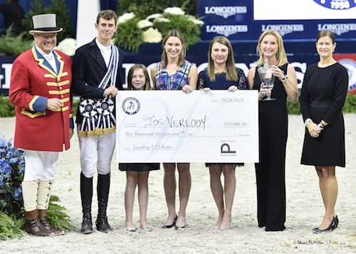 Jos Verlooy is presented with the Sleepy P Ranch Leading Under 25 Rider award and Juliet Weber Reid Trophy by ringmaster John Franzreb, Zola Thompson, WIHS Operations & Events Director Caitlin Lane, WIHS President Victoria Lowell, WIHS Director Emeritus Juliet Reid, and WIHS Executive Director Bridget Love Meehan.