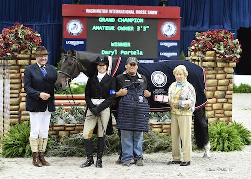"Daryl Portela and Winner in their Grand Champion Amateur-Owner Hunter 3'3"" presentation with ringmaster John Franzreb, groom Gerardo Briseno, and Betty Oare"