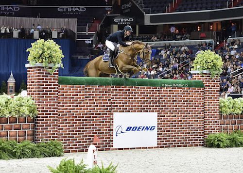 """Belgium's Jos Verlooy and Sunshine clear the Puissance wall at 2.13 meters (6'11"""")"""