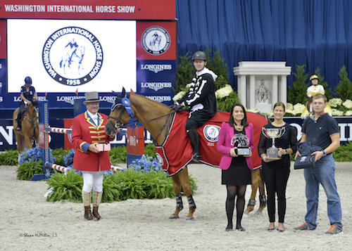 McLain Ward and HH Ashley in their winning presentation with ringmaster John Franzreb, WIHS Marketing & Communications Director Nara de Sá Guimarães, WIHS Executive Director Bridget Love Meehan, and HH Ashley's groom