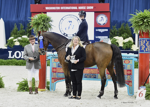 Taegan Long and Pollux de Shalimar in their winning presentation with ringmaster John Franzreb and Beth Strauss