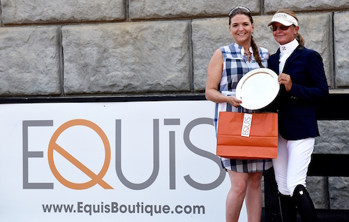 Irma Rubesa of Equis presents Candice King with Best Presented Horse honors at Tryon International Equestrian Center this summer.