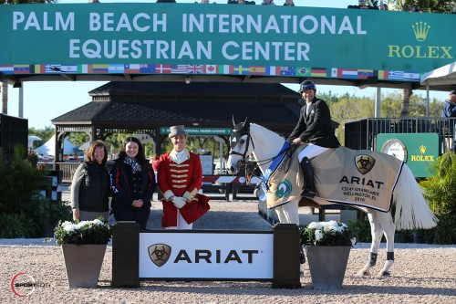 Eric Lamaze and Check Picobello Z in their winning presentation with Carlene Ziegler of Artisan Farms, Kasey Mowery of Ariat International, and ringmaster Christian Craig.