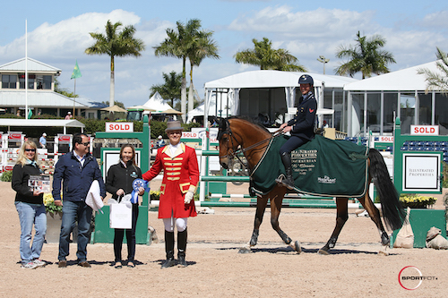 Lorenzo de Luca in his winning presentation (Aiyetoro standing in for Egano van het Slogenhof)  with Cathy Rogalny, Rodolfo Maya, and Waverly Ernst for The Maya Group at Illustrated Properties, and ringmaster Christian Craig.