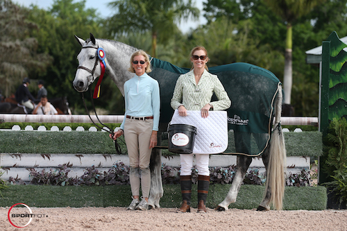 Clever Conversation in his championship presentation with owner Margaret O'Meara and Sally Stith-Burdette of Shapley's Grooming Products.