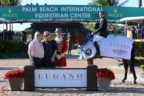 Darragh Kenny and Red Star d'Argent in their winning presentation with Stuart Winston, Vice President of Sales, Lugano Diamonds; Susan Franklin, Vice President of Marketing, Lugano Diamonds; and ringmaster Christian Craig.
