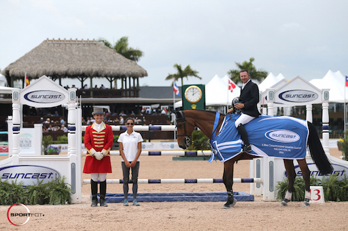 Eric Lamaze and Rosana du Park in their winning presentation with ringmaster Christian Craig and Lauren Tisbo of Suncast®.
