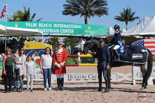Juana Trosch in the presentation for leading child rider with Maria Andrade of Hollow Creek Farm, ringmaster Christian Craig, and family.