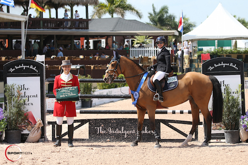 Margie Engle and Abunola in their winning presentation with ringmaster Christian Craig.