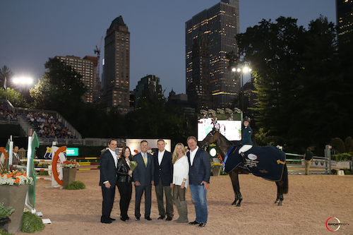 Junior/Amateur Jumper winners Alexandra Crown and Basic are joined  in their winning presentation with Dan and Ellen Crown, Ken Keller, CEO  of Luitpold Pharmaceuticals, Allyn Mann, Director of the Animal Health  Division, and Katherine and Mark Bellissimo.