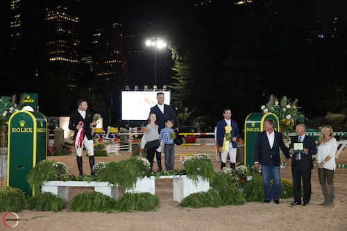 Jimmy Torano is joined by daughter Natalia and son JJ, along with second place finisher Sharn Wordley and third place rider Conor Swail, Mark Bellissimo of International Equestrian Group, Stewart Wicht, President and CEO of Rolex Watch U.S.A., and Katherine Bellissimo.