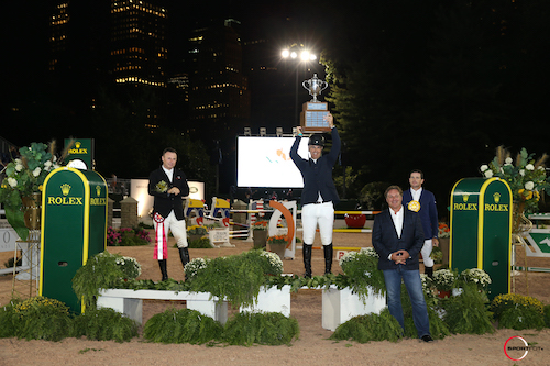 Jimmy Torano raises the trophy as the winner of the grand prix, joined by Sharn Wordley, Mark Bellissimo, and Conor Swail.