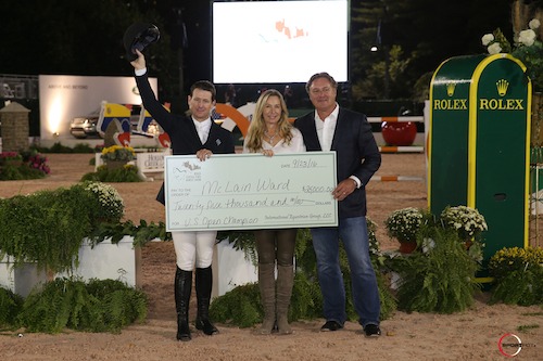 McLain Ward was presented with a bonus check for $25,000 for winning the U.S. Open title, presented by Mark and Katherine Bellissimo.