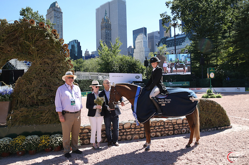 Michael Stone of International Equestrian Group with Becky and David Gochman congratulate pony hunter winners Zola Thompson and Elegance.